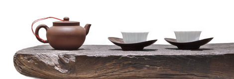 Teapot and cup on wood Stock Image