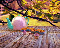 Teapot and cupcakes. Sweet and colourful cupcakes on retro-vintage background Royalty Free Stock Image