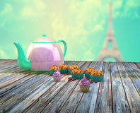 Teapot and cupcakes Stock Photography