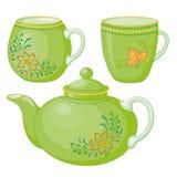 Teapot and cups Stock Photos