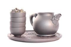 Teapot and cups. Close-up, isolated on white Royalty Free Stock Photo