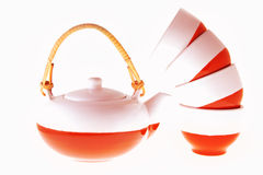 Teapot and cups. Isolated on white stock photo