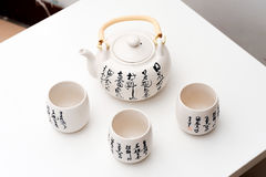The teapot and cups with the Chinese ancient patterns Stock Images