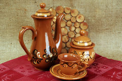 Teapot and cups from clay Stock Photos
