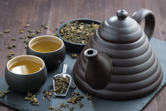 Teapot and cups with green tea Stock Image