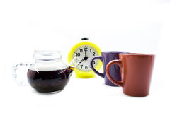 Teapot, cups and hours. Isolated on a white background Stock Photos