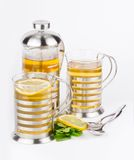 Teapot and cups with mint and lemon Royalty Free Stock Photo