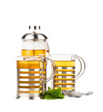 Teapot and cups with mint Royalty Free Stock Photos
