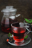 Teapot and cups of raspberry tea Royalty Free Stock Photography