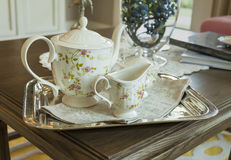 Teapot and cups on a stainless steel tray Royalty Free Stock Image