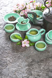 Teapot and cups on stone table. Asia style stil life Royalty Free Stock Image