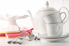 Teapot with cups and valentine cookies Stock Images
