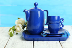 Teapot and cups on white wooden background Stock Photos