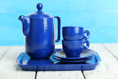 Teapot and cups on white wooden background Royalty Free Stock Photography