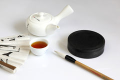 Teapot and dinette Stock Photo