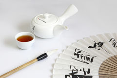 Teapot and dinette Stock Photography