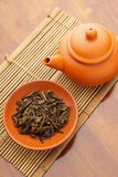 Teapot and dried tea leave Stock Photos
