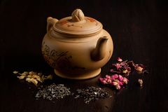 Teapot and dry tea variation Royalty Free Stock Image
