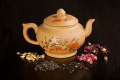 Teapot and dry tea variation Stock Photography