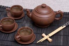 Teapot e copos cerâmicos Fotos de Stock