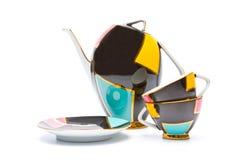 Teapot e copos da porcelana da cor isolados Foto de Stock