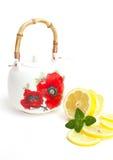 Teapot e fatias de limão Foto de Stock