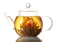 teapot för grön tea för exotiska blommor glass Arkivfoto