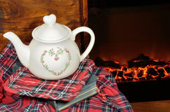 A teapot by the fireplace Royalty Free Stock Photography