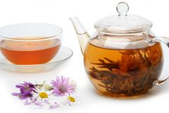 Teapot with floral brewed tea and flowers Royalty Free Stock Photo