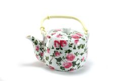 Teapot with floral ornament on white background Stock Photos