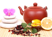 Teapot with flower Stock Images