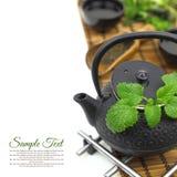 Teapot with fresh herbs Stock Photos