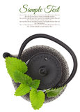 Teapot with fresh herbs Stock Image
