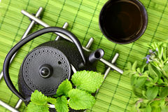 Teapot with fresh herbs Stock Photo