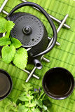 Teapot with fresh herbs Royalty Free Stock Images