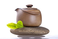 The teapot and fresh leaf on stone Royalty Free Stock Photo