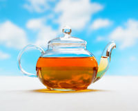 Teapot of fresh tea on natural background Royalty Free Stock Photo
