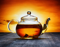 Teapot of fresh tea on sky background Royalty Free Stock Photo