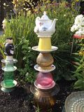 Teapot garden totem Royalty Free Stock Images