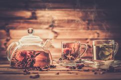 Teapot and glass cups stock image