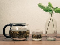 Teapot and glass Stock Photos