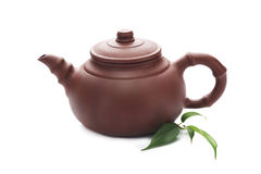 Teapot with green leaves isolated on white Stock Images