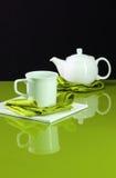 Teapot on Green Table Stock Photo