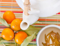 Teapot and green tea Stock Photo