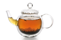 Teapot with green tea. On a white background Stock Photography