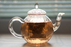 Teapot with green tea Stock Photography