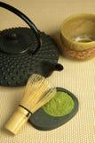 Teapot and green tea powder Royalty Free Stock Photos