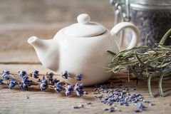 Teapot of healthy herbal tea and dry lavender flowers Stock Photos