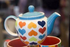 Teapot with hearts Stock Photo