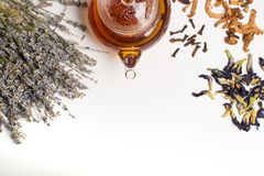 Teapot and herbal collection. stock photography
